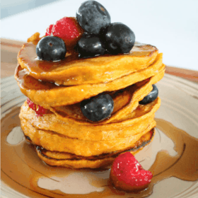 Pumpkin Spice Pancakes with Maple Syrup and Mixed Berries