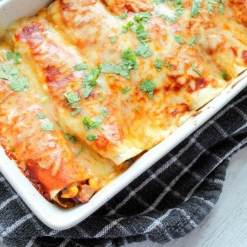 My kids go crazy for these!! Healthy chicken enchiladas with black beans and corn.